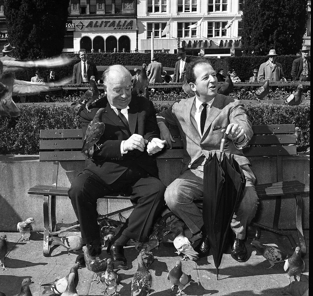 April 1, 1963: Herb Caen and Alfred Hitchcock feed the pigeons in Union Square during a promotion for Hitchcock's movie
