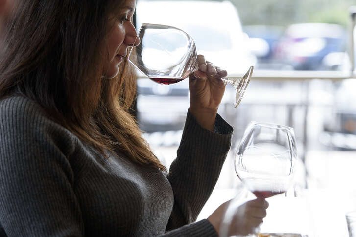 Guest Adriana Burruel sniffs a glass of   wine   during a tasting at the Hirsch Vineyards tasting room in Healdsburg, CA, on Saturday, February 24, 2018.