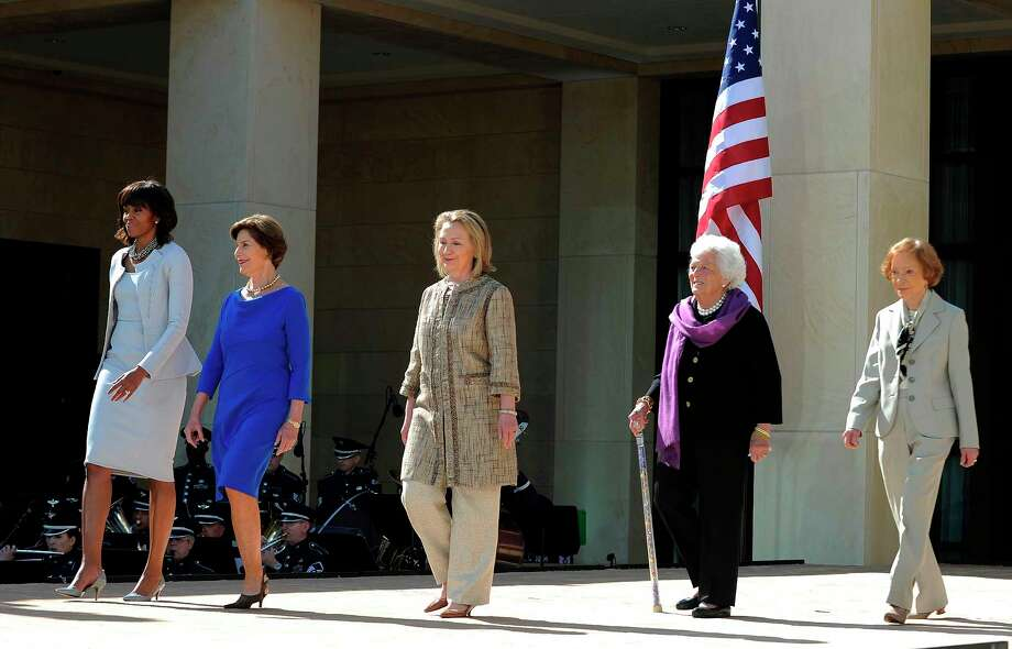 (FILES) In this file photo taken on April 25, 2013 US First Lady Michelle Obama (L) and former First Ladies (L-R) Laura Bush, Hillary Clinton, Barbara Bush and Roslyn Carter arrive on stage to attend the George W. Bush Presidential Center dedication ceremony in Dallas, Texas.  Former US first lady Barbara Bush died on Tuesday, April 17, 2018 at the age of 92 / AFP PHOTO / Jewel SAMADJEWEL SAMAD/AFP/Getty Images Photo: JEWEL SAMAD, AFP/Getty Images / AFP or licensors
