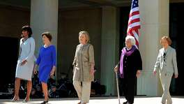 (FILES) In this file photo taken on April 25, 2013 US First Lady Michelle Obama (L) and former First Ladies (L-R) Laura Bush, Hillary Clinton, Barbara Bush and Roslyn Carter arrive on stage to attend the George W. Bush Presidential Center dedication ceremony in Dallas, Texas.  Former US first lady Barbara Bush died on Tuesday, April 17, 2018 at the age of 92 / AFP PHOTO / Jewel SAMADJEWEL SAMAD/AFP/Getty Images