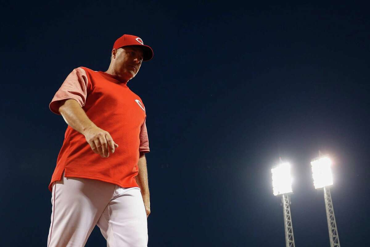 FILE - In this July 15, 2017, file photo, Cincinnati Reds manager Bryan Price walks back to the dugout in the seventh inning of a 10-7 loss in a baseball game against the Washington Nationals, in Cincinnati. The Reds have fired Bryan Price after a 3-15 start, the first managerial change in the major leagues this season. Price was in his fifth season leading the rebuilding team. The Reds have lost at least 94 games in each of the last three seasons while finishing last in the NL Central. Bench coach Jim Riggleman will manage the team on an interim basis. (AP Photo/John Minchillo, File)