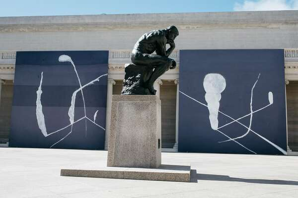 """Julian Schnabel: Symbols of Actual Life"" seen near the Rodin's The Thinker statue at the Legion of Honor in San Francisco, Calif., Monday, April 16, 2018."