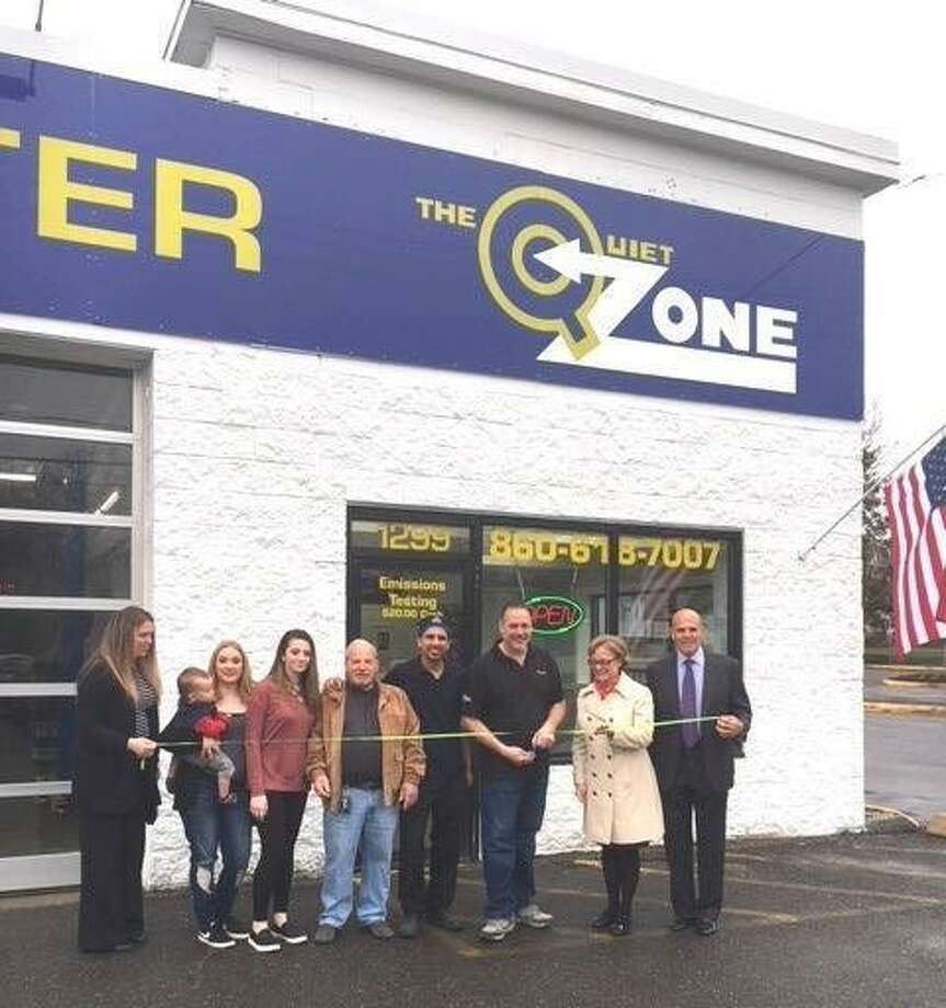 The Quiet Zone opened Thursday on East Main Street in Torrington with a ribbon cutting ceremony. Mayor Elinor Carbone, second from right, joined owner Frank Campagna, employees, family members and friends at the new automotive center. Below, the exterior of the shop. Photo: Tim Waldron /Contributed Photo
