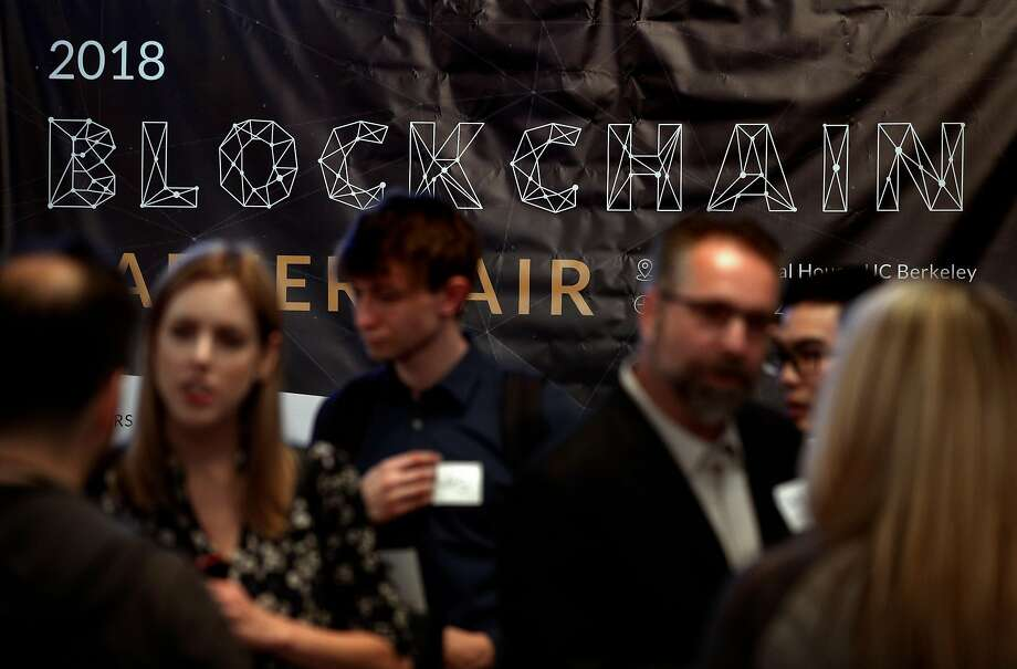 Several hundred people pack Chevron Auditorium for the Blockchain Career Fair, where companies sought engineers to work in the growing field, which, among other things, tracks cryptocurrrency. Photo: Photos By Carlos Avila Gonzalez / The Chronicle