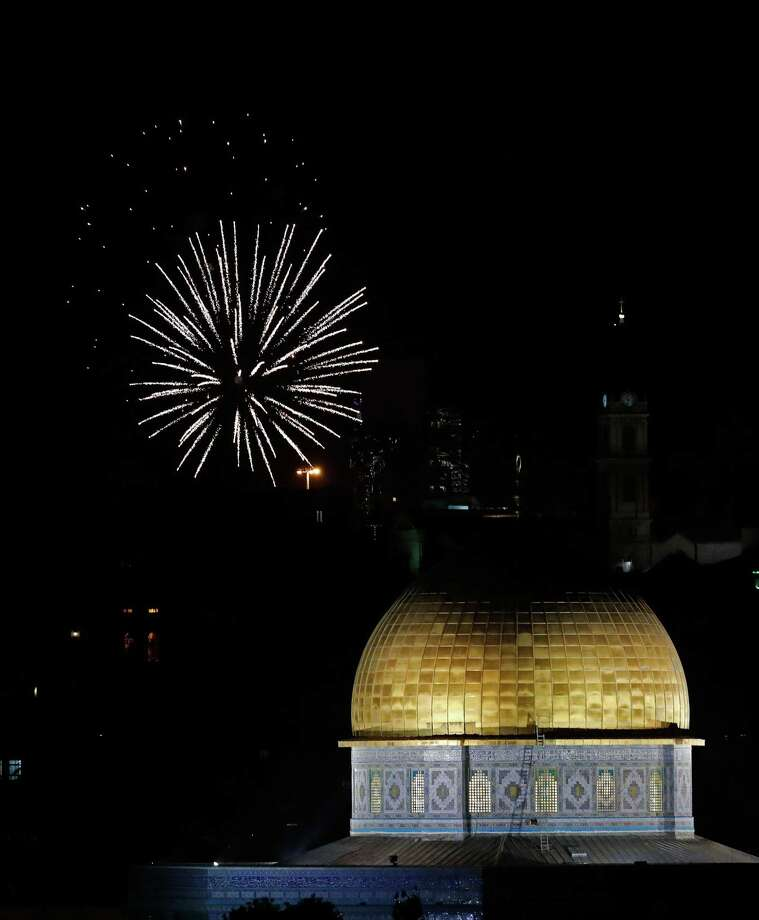 Fireworks explode over Jerusalem's Old City and the Dome of the Rock mosque (R) on April 18, as Israelis marks the end of Memorial Day and at the start of Israel's 70th Independence Day celebrations. Photo: THOMAS COEX, Contributor / AFP/Getty Images / AFP or licensors