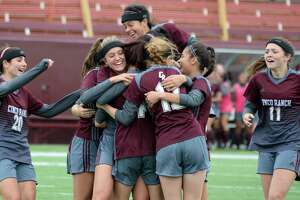 The Cinco Ranch Cougars celebrate their second goal during the second overtime period of a 6A-III regional final soccer playoff between the Cinco Ranch Cougars and the Tompkins Falcons on Saturday, April 14, 2018 at Abshier Stadium, Deer Park, TX.