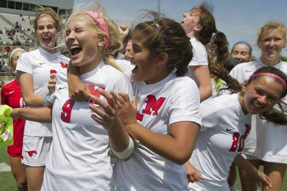 Memorial midfielder Grace Collins (9) reacts with teammates after defeating Round Rock 3-1 during a Region II-6A regional finals match at the Kelly Reeves Athletic Complex, Saturday, April 14, 2018, in Round Rock. Collins scored a goal and tallied two assist in Memorial's 3-1 win over Round Rock to advance to the UIL state tournament.