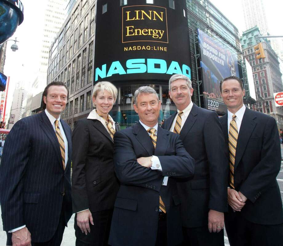 Linn Energy CFO Kolja Rockov, Senior Vice President and  General Counsel Charlene Ripley, Chairman, President & CEO Mark Ellis, COO Arden Walker, and Senior Vice President of Business Development David Rottino celebrated Linn s fifth anniversary as a publicly traded company by ringing the Nasdaq closing bell in April 2011. Several local unitholders joined them for the event, and they all wore ties with Linn colors. Photo: None / Linn Energy / Linn Energy