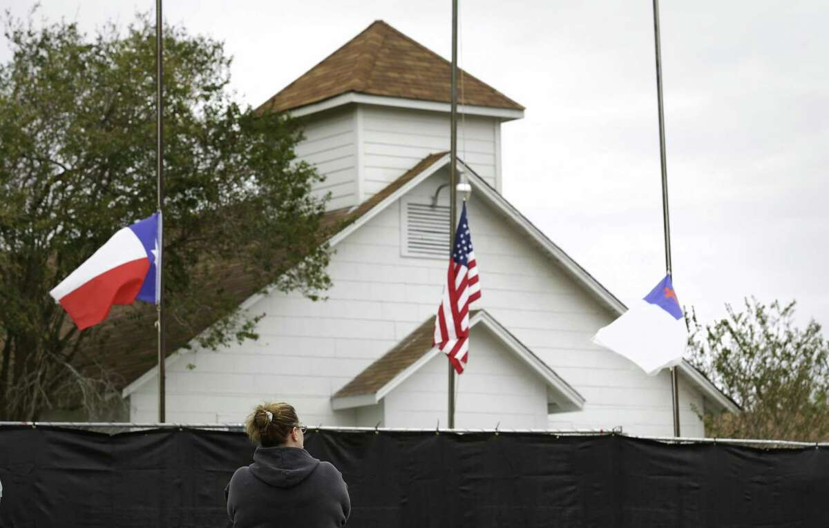Tonya Brockman of San Antonio pays her respects as she visits the First Baptist Church in Sutherland Springs after a mass shooting there in November.