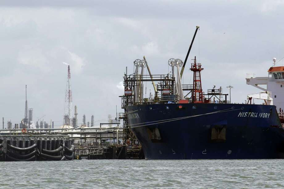 An oil tanker is docked at the Exxon Mobil Baytown complex along the Houston Ship Channel in Baytown, Texas. Exxon started a major planned maintenance outage at the oil refinery. Photo: David J. Phillip, STF / Associated Press / AP
