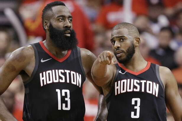 Houston Rockets guard Chris Paul (3) talks to guard James Harden during the second half in Game 2 of a first-round NBA basketball playoff series against the Minnesota Timberwolves, Wednesday, April 18, 2018, in Houston. (AP Photo/Eric Christian Smith)