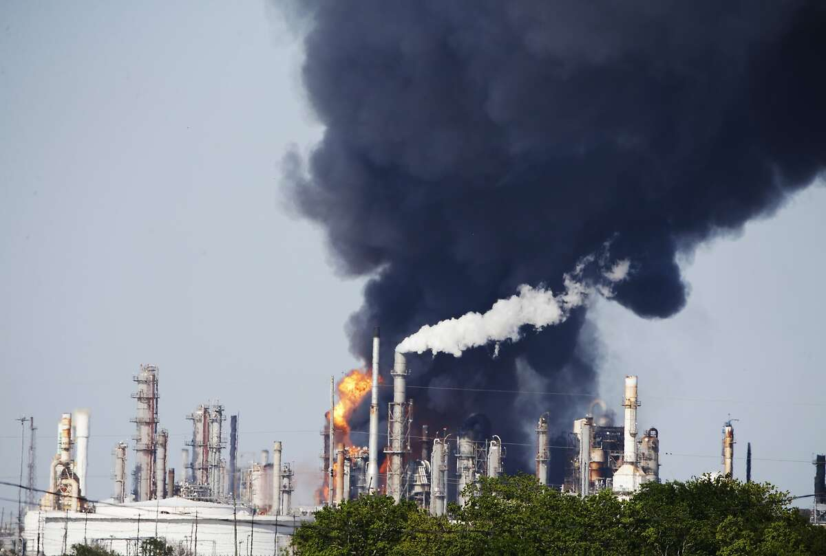 Flames and black smoke reach into the sky after an explosion at the Valero Texas City Refinery in Texas City, Texas, Thursday, April 19, 2018. (Kevin M. Cox/The Galveston County Daily News via AP)