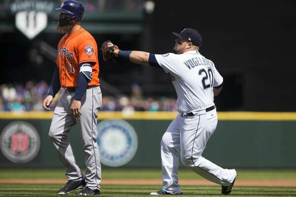 SEATTLE, WA - APRIL 19:  Daniel Vogelbach #20 of the Seattle Mariners tags Evan Gattis #11 of the Houston Astros out for a triple play as Gattis walks off the field thinking there were already three outs in the fourth inning at Safeco Field on April 19, 2018 in Seattle, Washington. (Photo by Lindsey Wasson/Getty Images)