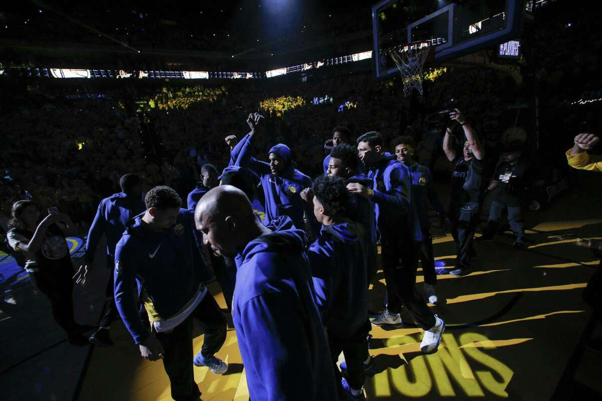 The Golden State Warriors are introduced before game 1 of round 1 of the Western Conference Finals at Oracle Arena on Saturday, April 14, 2018 in Oakland, Calif.