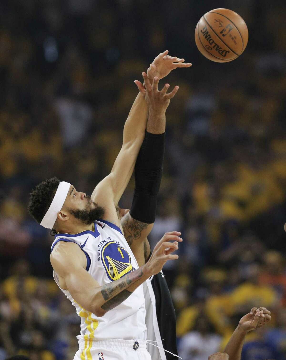 Golden State Warriors' JaVale McGee goes up against San Antonio Spurs' LaMarcus Aldridge for the opening tipoff during game 1 of round 1 of the Western Conference Finals at Oracle Arena on Saturday, April 14, 2018 in Oakland, Calif.