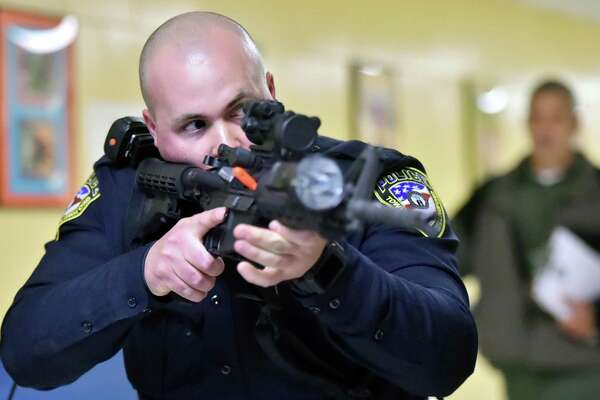 Wallingford police Detective Stephen Jacques during active shooter training Thursday at Moran Middle School.