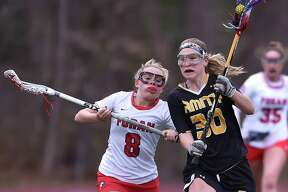 Foran midfielder Emily Kwalek battles Amity's Ana Carney at Vito DeVito Sports Complex, Thursday, April 19, 2018, at Foran High School in Milford. Amity won, 16-14,