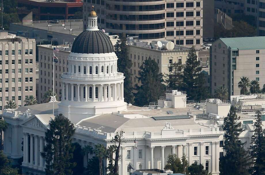 The State Capitol building in Sacramento. For the current fiscal year, as measured through Monday, state income taxes have totaled over $82 billion, nearly $4 billion ahead of projections. Photo: Paul Chinn / The Chronicle 2017