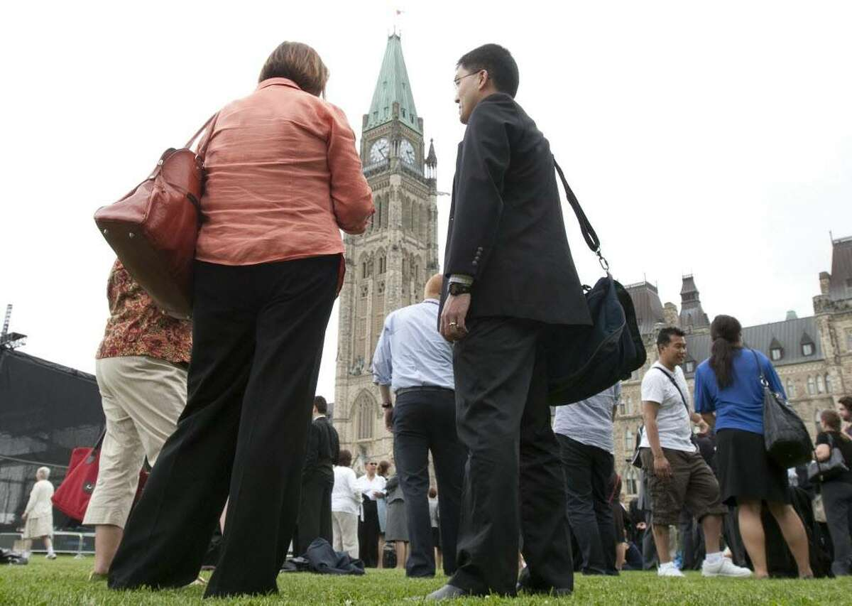 Senators, parliamentarians and their staff were evacuated from Parliament Buildings following a 5.5 magnitude earthquake in Ottawa, Canada on Wednesday June 23, 2010. Windows rattled, paintings wobbled on the walls and bewildered central Canadians wondered what in the world was going on Tuesday as a ??moderate earthquake?? rocked residents of southern Ontario, Quebec and the northeastern United States. (AP Photo/The Canadian Press, Adrian Wyld)