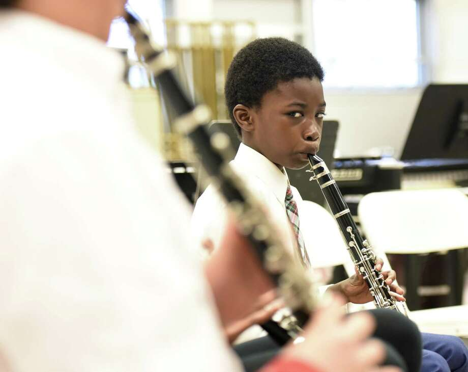 Fifth-grader Essowe Tedihou plays clarinet during Greenwich Alliance for Education's Tuning In To Music free lesson at Western Middle School in Greenwich, Conn. Tuesday, April 19, 2018. Members of the Greenwich Symphony taught group lessons to kids in grades four through 12. Students learned three songs and put on a performance for parents and teachers at the end. Photo: Tyler Sizemore / Hearst Connecticut Media / Greenwich Time