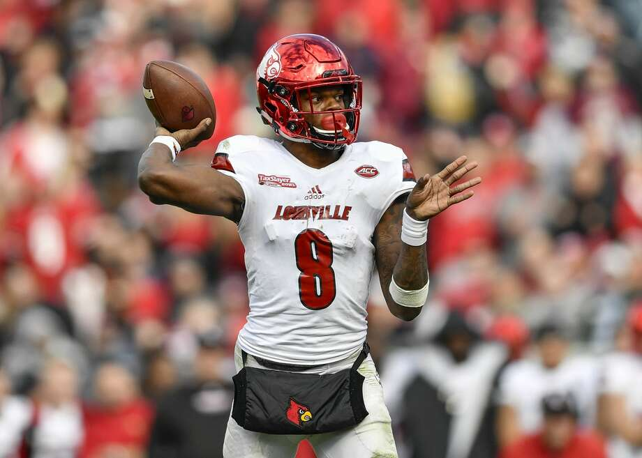 JACKSONVILLE, FL - DECEMBER 30: University of Louisville Cardinals quarterback Lamar Jackson (8) throws a pass from the pocket during the second half of the TaxSlayer Bowl game between the Louisville Cardinals and the Mississippi State Bulldogs on December 30, 2017, at Everbank Field in Jacksonville, FL. Mississippi State defeated Louisville 31-27. (Photo by Roy K. Miller/Icon Sportswire via Getty Images) Photo: Icon Sportswire/Icon Sportswire Via Getty Images