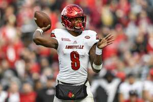 JACKSONVILLE, FL - DECEMBER 30: University of Louisville Cardinals quarterback Lamar Jackson (8) throws a pass from the pocket during the second half of the TaxSlayer Bowl game between the Louisville Cardinals and the Mississippi State Bulldogs on December 30, 2017, at Everbank Field in Jacksonville, FL. Mississippi State defeated Louisville 31-27. (Photo by Roy K. Miller/Icon Sportswire via Getty Images)