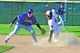 Edwardsville junior Joe Copeland, right, steals second base during the fourth inning of Thursday's Southwestern Conference game against Collinsville at Tom Pile Field.