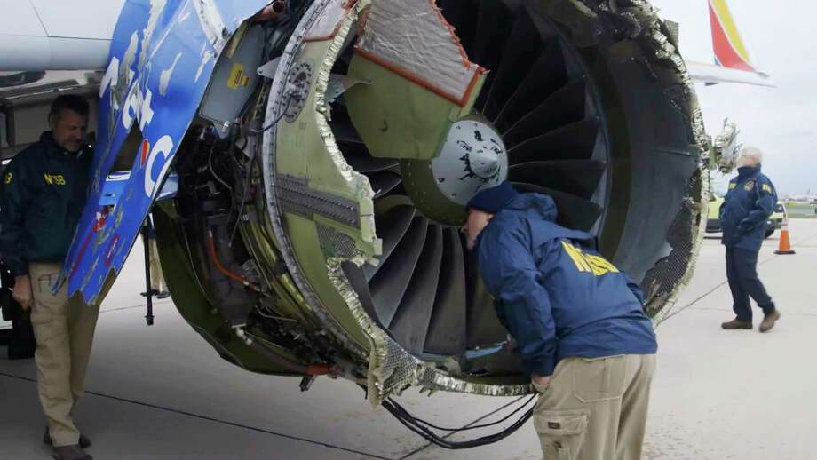 In a video still image provided by the National Transportation Safety Board, investigators in Philadelphia examine the damaged engine that caused the death of a passenger on a Southwest Airlines plane on Tuesday, April 17, 2018. The engine on the plane broke apart shortly after takeoff from La Guardia Airport in New York, killing a woman sitting in a window seat near the blast. (NTSB via The New York Times) **EDITORIAL USE ONLY ** Photo: NATIONAL TRANSPORTATION SAFETY BOARD / NATIONAL TRANSPORTATION SAFETY BOARD