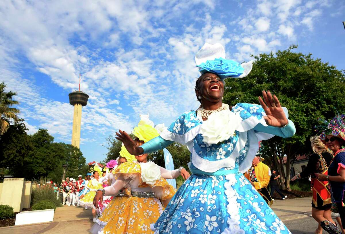Deirdre LaCour of the drum and dance group Urban 15 leads others through Hemisfair during Fiesta Fiesta, the first event of the 11 days of Fiesta San Antonio, on Thursday, April 19, 2018.