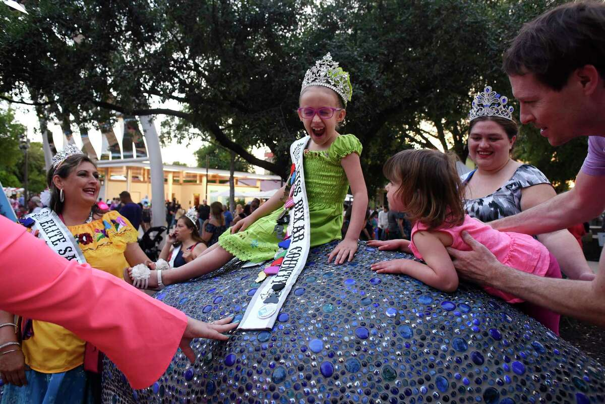Laney Villanueva, who is Fiesta royalty as Little Miss Bexar County, is the center of attention as she plays at Yanaguana Gardens in Hemisfar during Fiesta Fiesta, the first event of the 11 days of Fiesta San Antonio, on Thursday, April 19, 2018.