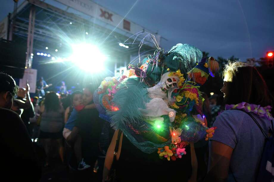 A Fiesta-style hat adorns the head of a person enjoying a concert during Fiesta Fiesta, the first event of the 11 days of Fiesta San Antonio on Thursday, April 19, 2018. Photo: Billy Calzada, San Antonio Express-News / San Antonio Express-News