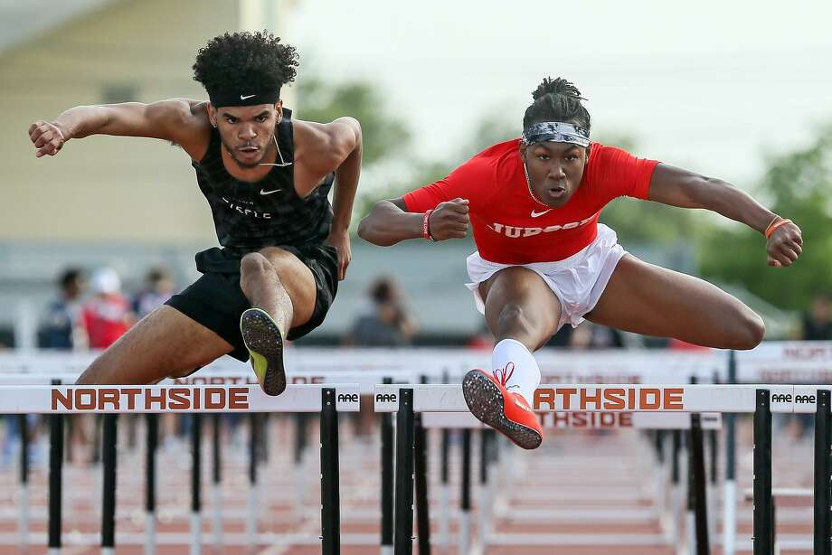 Steele's Kenney Broadnax (left) and Judson's Tre'Bien Gilbert clear the final hurdle in the boys 110-meter hurdles during the District 27/28-6A area meet at Gustafson Stadium on Thursday, April 19, 2018.  MARVIN PFEIFFER/mpfeiffer@express-news.net Photo: Marvin Pfeiffer, Staff / San Antonio Express-News / Express-News 2018
