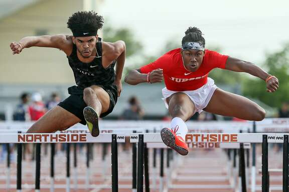 Steele's Kenney Broadnax (left) and Judson's Tre'Bien Gilbert clear the final hurdle in the boys 110-meter hurdles during the District 27/28-6A area meet at Gustafson Stadium on Thursday, April 19, 2018.  MARVIN PFEIFFER/mpfeiffer@express-news.net