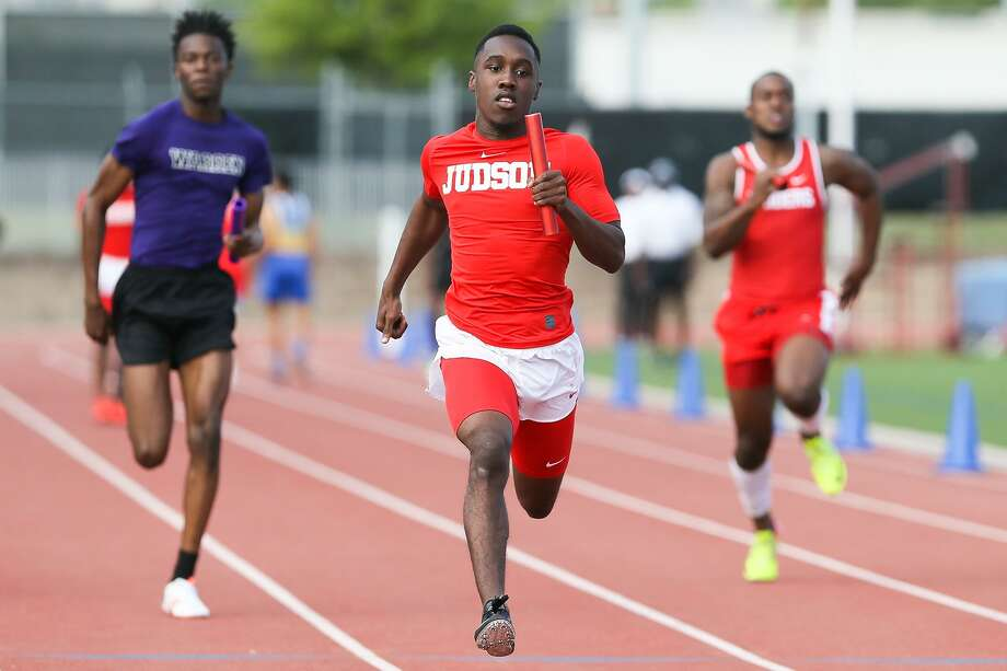 Judson's Kenyon Morgan (center) approaches the finish line of the boys 400-meter relay during the District 27/28-6A area meet at Gustafson Stadium on Thursday, April 19, 2018.  Judson swept all three relays at the meet.  MARVIN PFEIFFER/mpfeiffer@express-news.net Photo: Marvin Pfeiffer, Staff / San Antonio Express-News / Express-News 2018