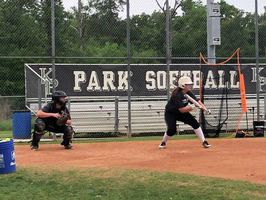 Mikaela Tellez squares up to bunt during a Kingwood Park softball practice on April 18 Photo: Elliott Lapin / Elliott Lapin
