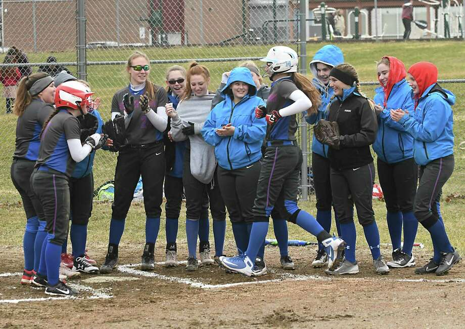 South Glens Falls players surround home plate to celebrate Zoe Lanfear's home run during a softball game against Burnt Hills on Tuesday, April 17, 2018 in Burnt Hills, N.Y. (Lori Van Buren/Times Union) Photo: Lori Van Buren / 40043531A