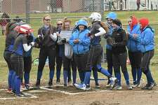 South Glens Falls players surround home plate to celebrate Zoe Lanfear's home run during a softball game against Burnt Hills on Tuesday, April 17, 2018 in Burnt Hills, N.Y. (Lori Van Buren/Times Union)