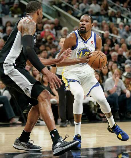 Golden State Warriors' Kevin Durant (35) drives against San Antonio Spurs' LaMarcus Aldridge during the first half of Game 4 of a first-round NBA basketball playoff series in San Antonio, Sunday, April 22, 2018, in San Antonio. (AP Photo/Darren Abate) Photo: Darren Abate, Associated Press / FR115 AP