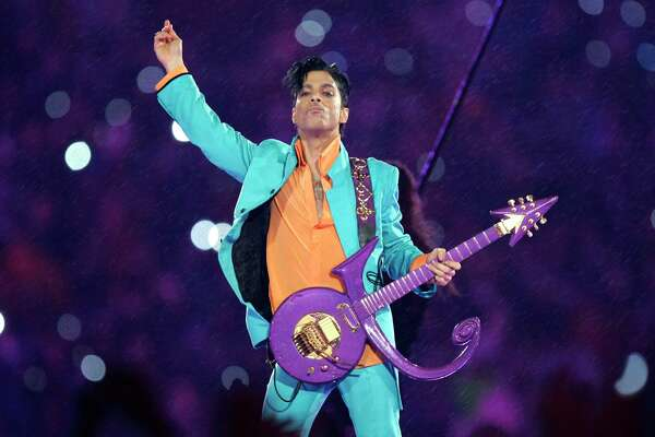 FILE - In this Feb. 4, 2007 file photo, Prince performs during the halftime show at the Super Bowl XLI football game at Dolphin Stadium in Miami. A tribute fence will be installed at Prince's famed music studio and home in Minnesota as officials prepare for fans returning on the second anniversary of the rock star's death. A three-day celebration of the late musician also will be held next month, including a concert in Minneapolis. The tribute fence will be set up inside the grounds at Paisley Park, where Prince died from an accidental painkiller overdose on April 21, 2016. (AP Photo/Chris O'Meara, File)