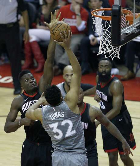 Houston Rockets center Clint Capela (15) blocks a shot from Minnesota Timberwolves center Karl-Anthony Towns (32) as the Houston Rockets take on the Minnesota Timberwolves in the first half of Game 2 of the first round of the NBA Playoffs at the Toyota Center Wednesday, April 18, 2018 in Houston. (Michael Ciaglo / Houston Chronicle) Photo: Michael Ciaglo, Houston Chronicle / Houston Chronicle / Michael Ciaglo