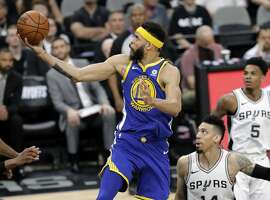Golden State Warriors center JaVale McGee (1) goes up for a shot after getting past Danny Green (14) in the second half of Game 3 of a first-round NBA basketball playoff series in San Antonio, Thursday, April 19, 2018. (AP Photo/Eric Gay)