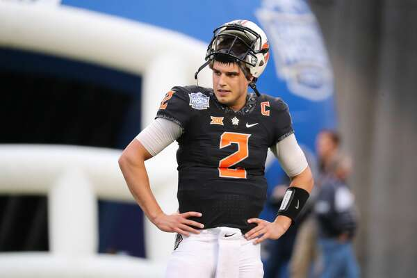 ORLANDO, FL - DECEMBER 28: Oklahoma State Cowboys quarterback Mason Rudolph (2) warms up before the Camping World Bowl between the Virginia Tech Hokies and the Oklahoma State Cowboys on December 28, 2017 at Camping World Stadium in Orlando FL. (Photo by Joe Petro/Icon Sportswire via Getty Images)