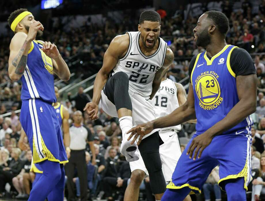 San Antonio Spurs forward Rudy Gay (22) reacts after dunking between Golden State Warriors center JaVale McGee (1) and forward Draymond Green (23) during first half action Thursday April 19, 2018 at the AT&T Center. Photo: Edward A. Ornelas, Staff / San Antonio Express-News / © 2018 San Antonio Express-News