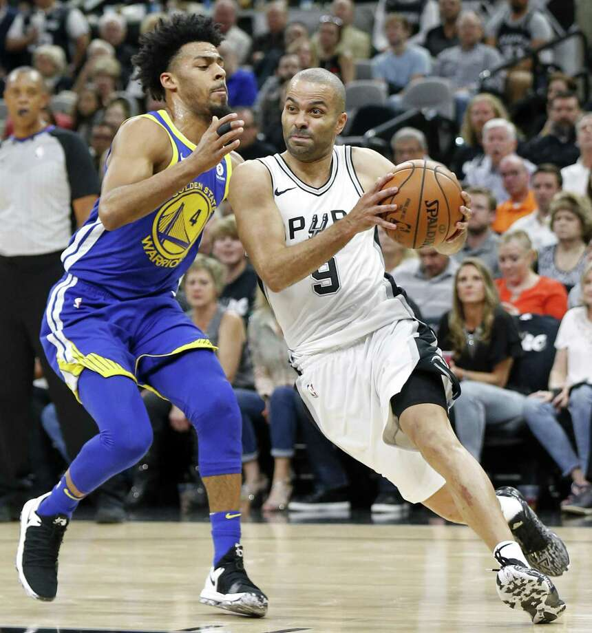 San Antonio Spurs guard Tony Parker (9) drives around Golden State Warriors guard Quinn Cook (4) during first half action Thursday April 19, 2018 at the AT&T Center. Photo: Edward A. Ornelas,  Staff / San Antonio Express-News / © 2018 San Antonio Express-News