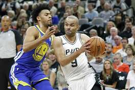 San Antonio Spurs guard Tony Parker (9) drives around Golden State Warriors guard Quinn Cook (4) during first half action Thursday April 19, 2018 at the AT&T Center.