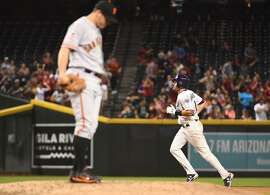 A.J. Pollock #11 of the Arizona Diamondbacks hits a solo home run against Ty Blach #50 of the San Francisco Giants during the sixth inning of the MLB game at Chase Field on April 19, 2018 in Phoenix, Arizona.