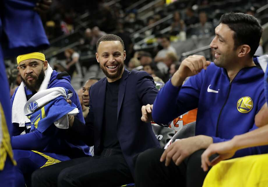 Golden State Warriors' JaVale McGee watches as Stephen Curry, center, jokes with Zaza Pachulia, right, during the second half of Game 3 of the team's first-round NBA basketball playoff series against the San Antonio Spurs in San Antonio, Thursday, April 19, 2018. Golden State won 110-97. (AP Photo/Eric Gay) Photo: Eric Gay, Associated Press