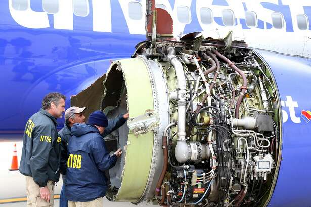 PHILADELPHIA, PA - APRIL 17: In this National Transportation Safety Board handout, NTSB investigators examine damage to the CFM International 56-7B turbofan engine belonging Southwest Airlines Flight 1380 that separated during flight Philadelphia International Airport April 17, 2018 in Philadelphia, Pennsylvania. Investigators can't explain with certainty why the left engine in the Boeing 737 malfunctioned but are directing their attention to metal fatigue on fan blades. One woman died during the incident.  (Photo by Keith Holloway/National Transportation Safety Board via Getty Images)