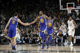 Golden State Warriors' Klay Thompson (11) and Kevin Durant (35) celebrate a basket as San Antonio Spurs' LaMarcus Aldridge (12) runs up the court during the second half of Game 3 of a first-round NBA basketball playoff series in San Antonio, Thursday, April 19, 2018. Golden State won 110-97. (AP Photo/Eric Gay)