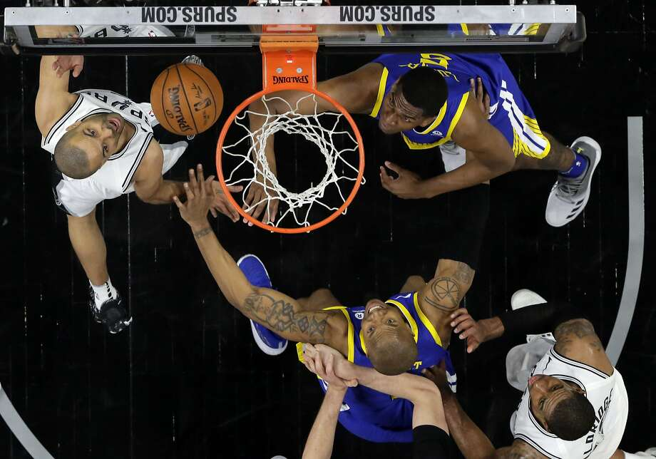 San Antonio Spurs' Tony Parker, left, takes a shot as Golden State Warriors' David West, bottom, and Kevon Looney, right, defend in the second half of Game 3 of a first-round NBA basketball playoff series in San Antonio, Thursday, April 19, 2018. Golden State won 110-97. (AP Photo/Eric Gay) Photo: Eric Gay, Associated Press